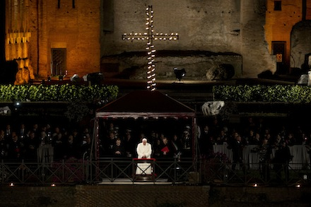 Pope Francis leads the Via Crucis (Way of the Cross) torchlight procession celebrated in front of the Colosseum on Good Friday in Rome, Friday, April 18, 2014. The evening Via Crucis procession at the ancient amphitheater is a Rome tradition that draws a large crowd of faithful, including many of the pilgrims who flock to the Italian capital for Holy Week ceremonies before Easter Sunday. (AP Photo/Andrew Medichini)